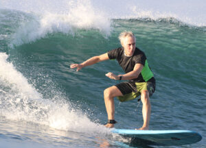mike downey rides a wave
